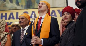 Canada's PM Trudeau holds a ceremonial sword during a Vaisakhi celebration on Parliament Hill in Ottawa