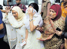 People react near the Holey Artisan restaurant after Islamist militants attacked the upscale cafe in Dhaka